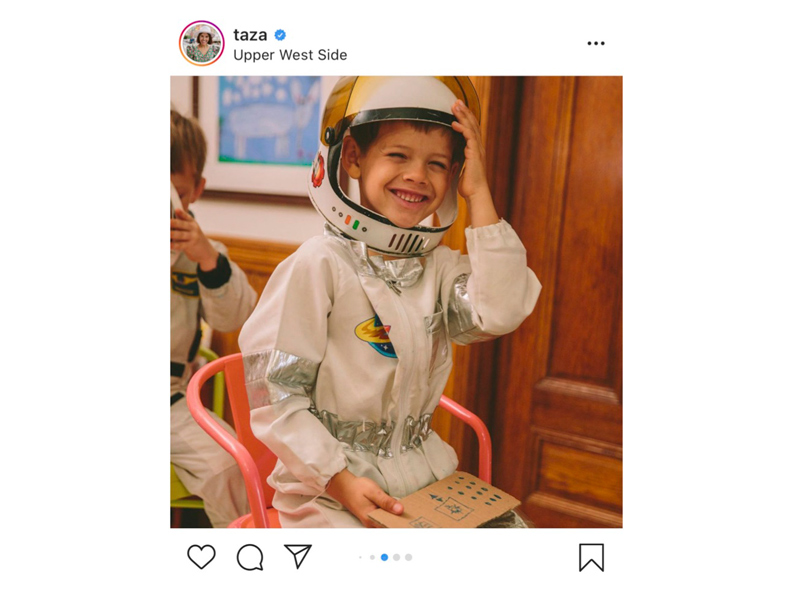 A child wearing an astronaut costume